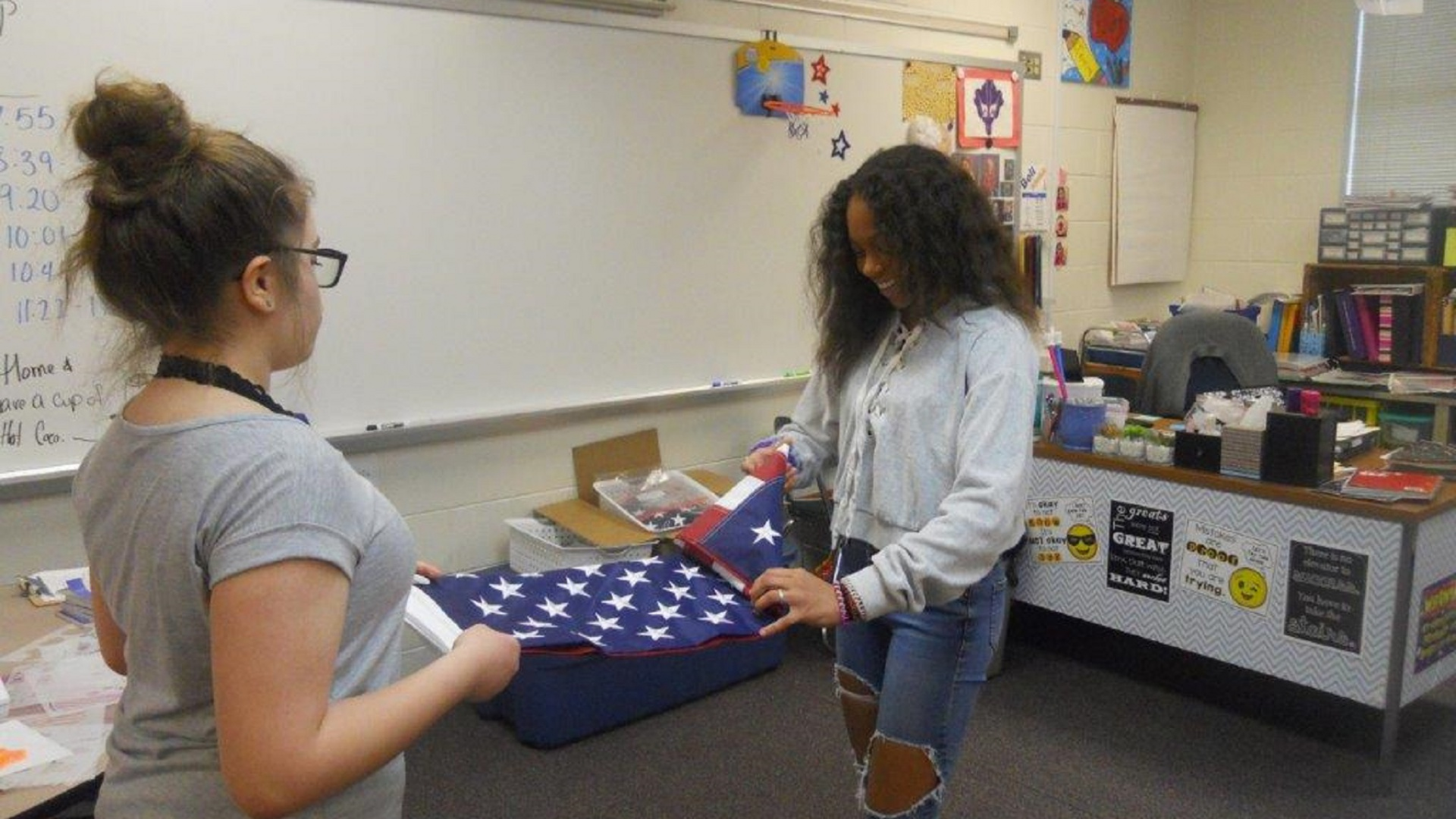7th graders learning to fold the American Flag